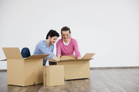 happy Young couple moving in new home photo