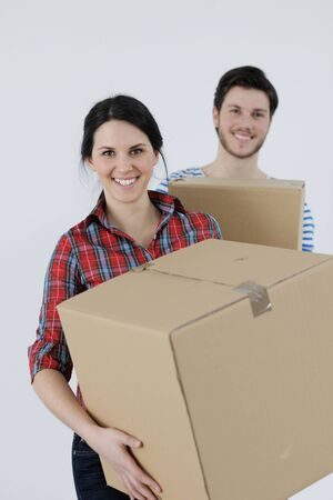 happy Young couple moving in new home Stock Photo - 13775285