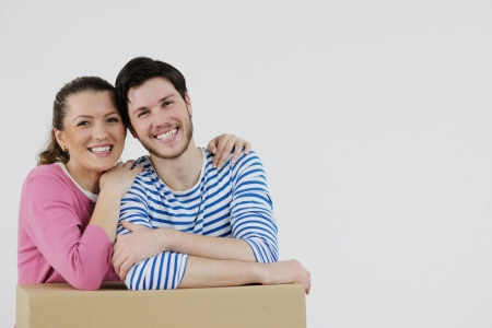 happy Young couple moving in new home Stock Photo - 13775252