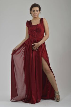 elegant woman in  fashionable  stylish dress posing in the studio Stock Photo - 13793597