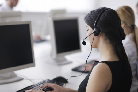 business people group with  headphones giving support in  help desk office to customers, manager giving training and education instructions Stock Photo - 13909376