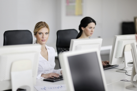 business people group with  headphones giving support in  help desk office to customers, manager giving training and education instructions Stock Photo - 17621677