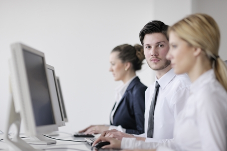 business people group with  headphones giving support in  help desk office to customers, manager giving training and education instructions Stock Photo - 13909051