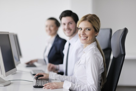 business people group with  headphones giving support in  help desk office to customers, manager giving training and education instructions Stock Photo - 13909303