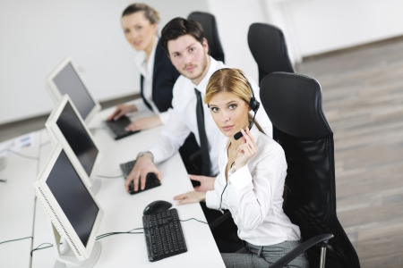 business people group with  headphones giving support in  help desk office to customers, manager giving training and education instructions Stock Photo - 13909144