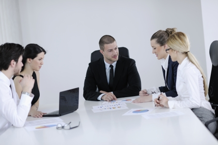 Group of happy young  business people in a meeting at office Stock Photo - 13909333