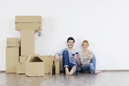 happy Young couple moving in new home Stock Photo - 13909380