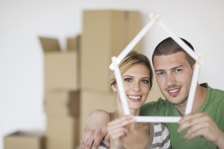 happy Young couple moving in new home Stock Photo - 13909133
