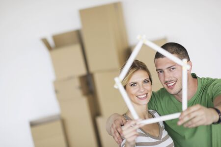 happy Young couple moving in new home Stock Photo - 13909126