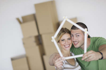 moving in: happy Young couple moving in new home Stock Photo