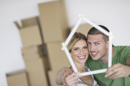 happy Young couple moving in new home Stock Photo - 13909130