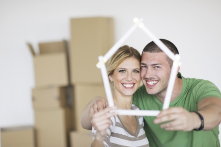 loans: happy Young couple moving in new home Stock Photo