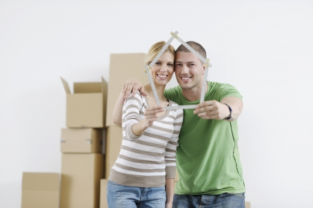 move in: happy Young couple moving in new home Stock Photo
