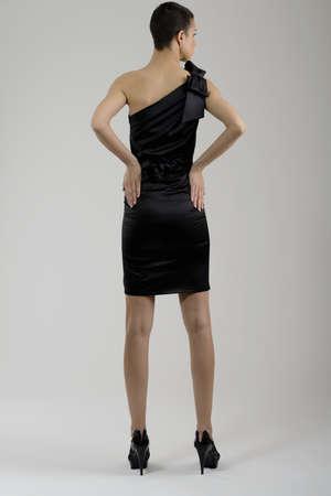 sexy black dress: elegant woman in  fashionable  stylish dress posing in the studio