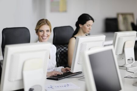 corporate training: business people group with  headphones giving support in  help desk office to customers, manager giving training and education instructions Stock Photo