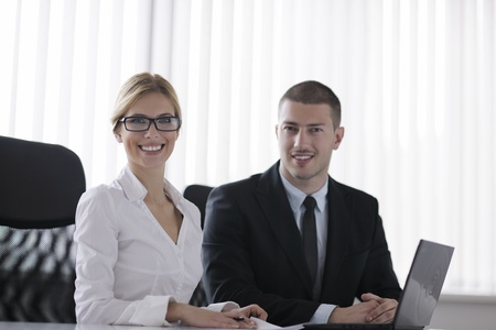 Group of happy young  business people in a meeting at office Stock Photo - 13974414