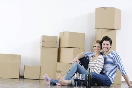 happy Young couple moving in new home Stock Photo - 13973825