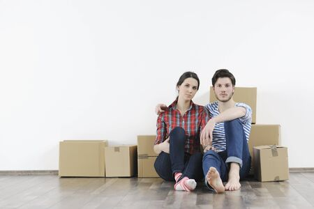 happy Young couple moving in new home Stock Photo - 13973817
