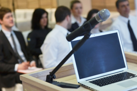 news room: business laptop and microphotone at podium on seminar conference education Stock Photo