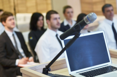 business laptop and microphotone at podium on seminar conference education photo