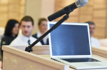 copy room: business laptop and microphotone at podium on seminar conference education Stock Photo