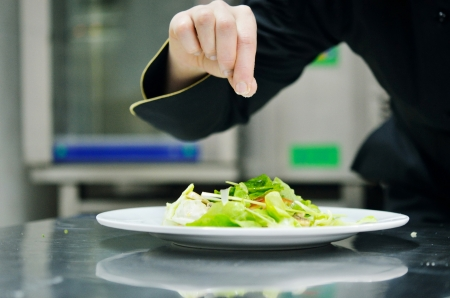culinary chef: beautiful young chef woman prepare and decorating tasty food in kitchen