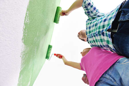 happy couple paint wall at new home Stock Photo - 14218782
