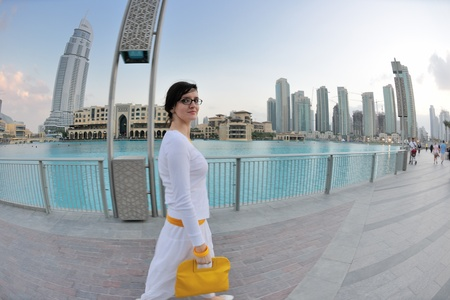 beautiful young woman tourist in dubai and abu dhabi  at vacation and travel trip photo