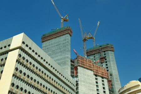 Construction site with crane and building photo