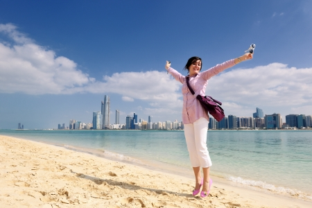 dubai: beautiful young woman tourist in dubai and abu dhabi  at vacation and travel trip
