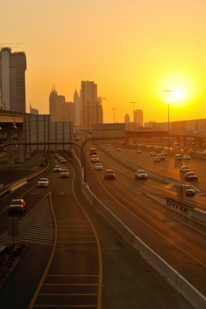 traffic jam in big city at sunset photo