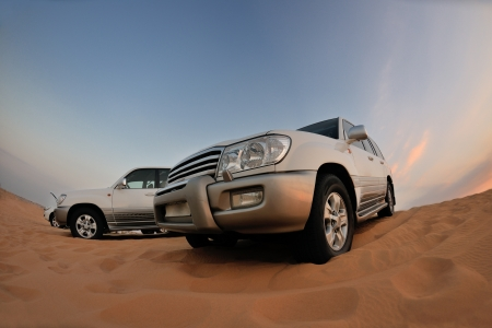 rover: Desert Safari - Off-road jeep vehicles driving in the Arabian Desert at sunset