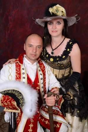 retro happy young couple people in victorian fashion clothes photo