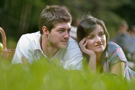 happy young romantic couple in love   having a picnic outdoor on a summer day Stock Photo - 14487439