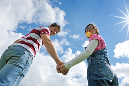 Portrait of romantic young couple in love  smiling together outdoor in nature with blue sky in background Stock Photo - 14999961