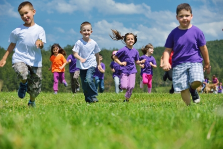 happy kids group have fun in nature outdoors park photo