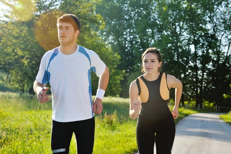 Young couple jogging in park at morning. Health and fitness. Stock Photo - 14670542