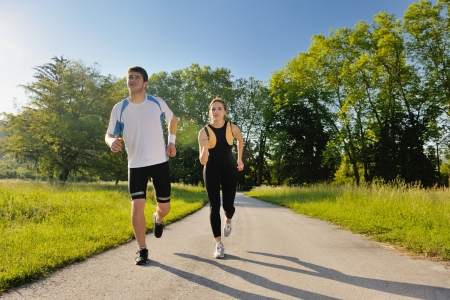 Young couple jogging in park at morning. Health and fitness. Stock Photo - 14670678