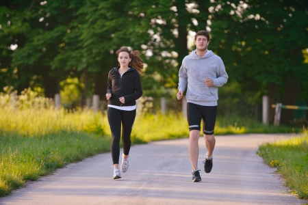 Young couple jogging in park at morning. Health and fitness. Stock Photo - 14670682
