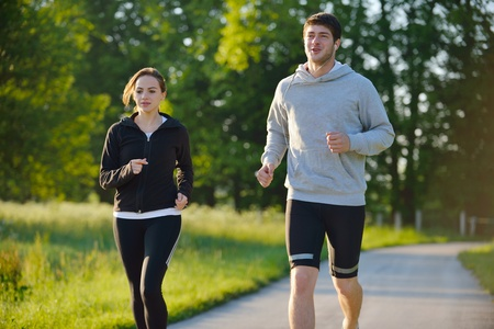 Young couple jogging in park at morning. Health and fitness. Stock Photo - 14670599