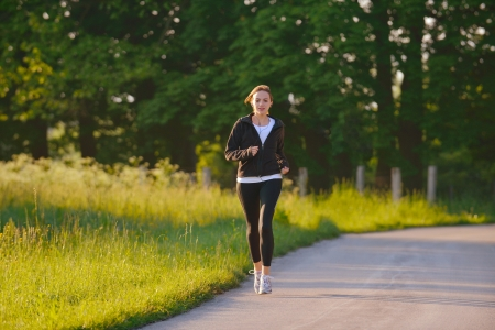 Young couple jogging in park at morning. Health and fitness. Stock Photo - 14670680