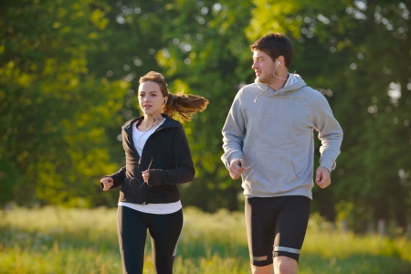 Young couple jogging in park at morning. Health and fitness. Stock Photo - 14670452