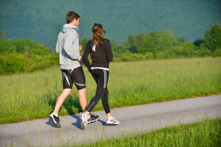 Young couple jogging in park at morning. Health and fitness. Stock Photo - 14670686