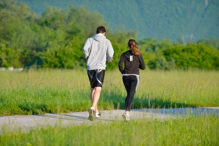 Young couple jogging in park at morning. Health and fitness. Stock Photo - 14625911
