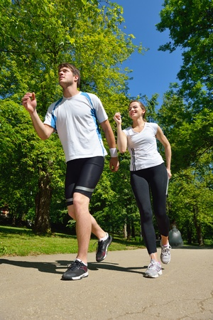 Young couple jogging in park at morning. Health and fitness. Stock Photo - 14703521