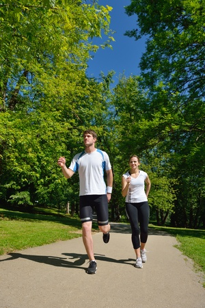 Young couple jogging in park at morning. Health and fitness. Stock Photo - 14703523