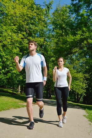 Young couple jogging in park at morning. Health and fitness. Stock Photo - 14703522