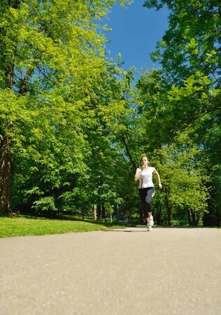 Young beautiful  woman jogging in summer park. Woman in sport outdoors health concept Stock Photo - 14703519