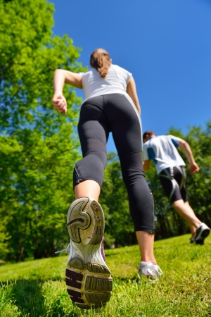 Young couple jogging in park at morning. Health and fitness. Stock Photo - 14703514