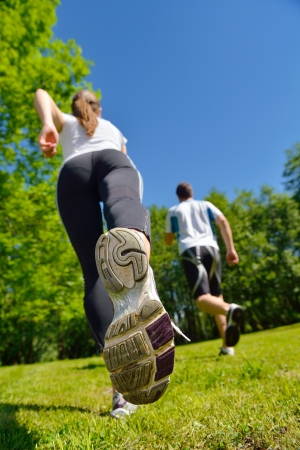 Young couple jogging in park at morning. Health and fitness. Stock Photo - 14703507